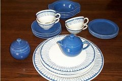 bird_pottery_trellis_plates_and_cups_and_early_californis_blue_bowls_saucers_cream_and_sugar