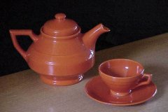 early_california_angular_teapot_and_angular_cup_and_saucer_in_orange